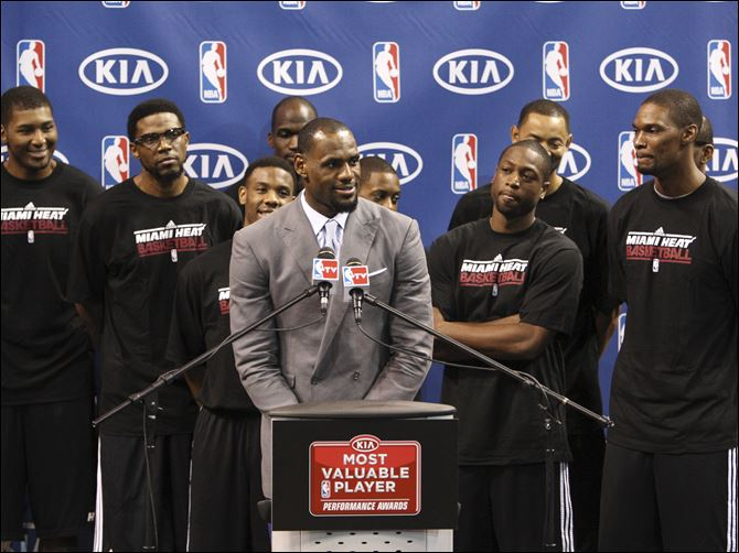 Surrounded by teammates, Miami Heat's LeBron James  Surrounded by teammates, Miami Heat's LeBron James speaks after having accepted the NBA MVP trophy, Saturday, in Miami. Calling the honor