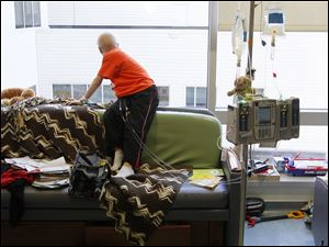 Alex Carman, 8, of Perrysburg, looks out the window of his room at Toledo Children's Hospital.  Alex, who has leukemia, has been in the hospital for nearly two months.