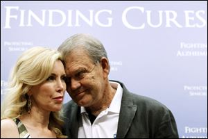 Country singer Glen Campbell, who has Alzheimer's disease, stands with his wife Kim during a news conference on Capitol Hill in Washington, Tuesday.