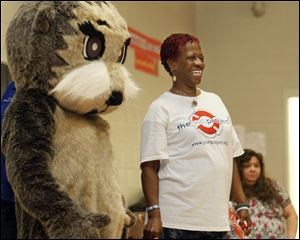 Wanda Jean Butts is joined by mascot 'Josh the Baby Otter.'