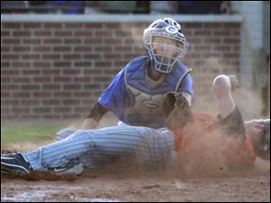 Generals catcher Jordan Nell (7) tags out Ashland player Gabe Bradshaw (6) at home in the fifth inning.