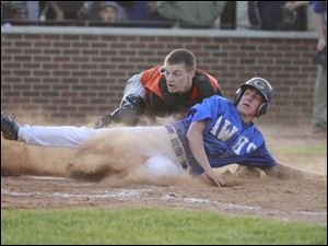 Anthony Wayne's Josh Schwerer (8) is tagged out by Ashland catcher Jordan Blair (10) in the fifth inning.