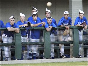 Anthony Wayne High School players have their rally caps on as they watch a hit by teammate Tyler Deye (5) in the fifth inning.