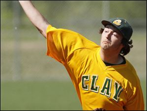 Clay pitcher Jordan Grosjean (16) throws against the Titans.