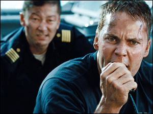 Tadanobu Asano, left, and Taylor Kitsch in a scene from 'Battleship.'