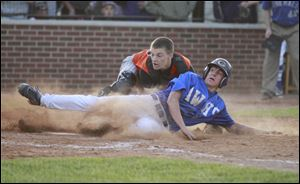Anthony Wayne's Josh Schwerer is tagged out by Ashland catcher Jordan Blair in the fi fth inning. Th e Generals are 23-3.