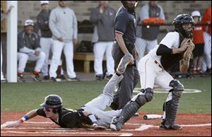 Southview catcher Daniel Barnes forces out Northview's Connor Hartnett in the third inning of the Cougars' 4-3 victory.
