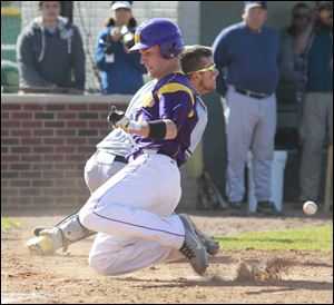 Maumee's David McCrum scores as Norwalk catcher Dustin Lieber takes the throw in the fourth inning. Th e Panthers are 17-9.