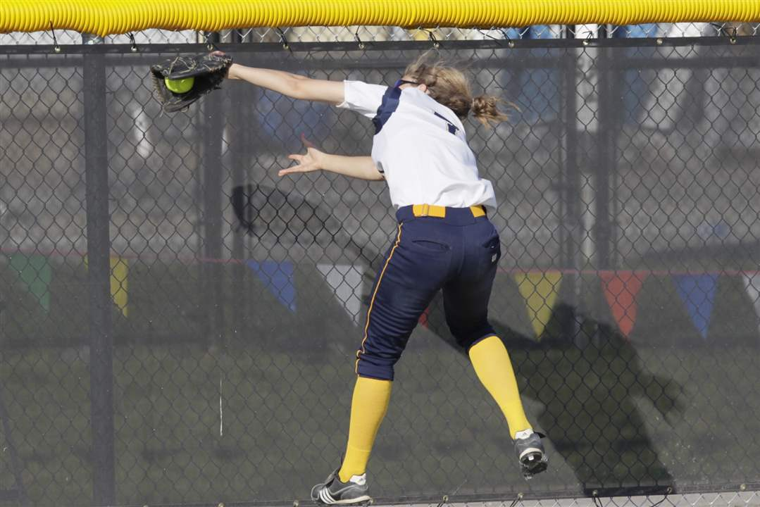 NDA-left-fielder-Molly-Walters-makes-a-catch-at-the-wal
