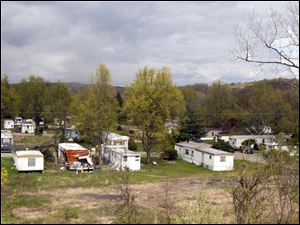 The Pine-Aire Trailer Park Village in Athens Township is nestled under State Rte 33. The mobile park was hit by a tornado in 2010 leaving debris, overturned trailers and trees.