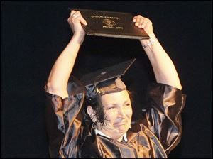 Tracy Wendell with her Bachelor of Science in Nursing. Over 300 students are graduated at the 54th commencement of Lourdes University in Toledo, Ohio on May 19, 2012. It was the first commencement for Lourdes as a university, and the last for outgoing president Robert Helmer, PhD., J.D. Dr. Elizabeth S. Ruppert, M.D., gave the commencement address; she and Robert Maxwell received honorary degrees.
