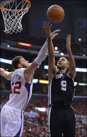 San Antonio's Tony Parker puts up a shot against Los Angeles' Blake Griffin.