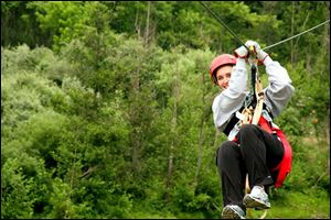 Ride a zipline  at The Wild Zipline Safari in Muskingum County.
