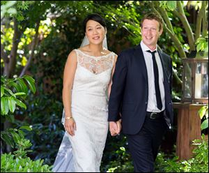 Mark Zuckerberg, Facebook founder and CEO, and his longtime girlfriend, Priscilla Chan, pause at their wedding. The fewer than 100 guests at the Saturday event thought they were invited to a graduation party for her.