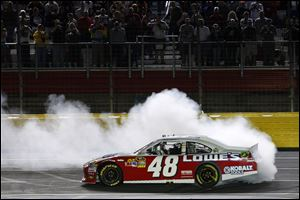 Jimmie Johnson does a burnout to celebrate winning the NASCAR Sprint Cup All-Star race Saturday night.