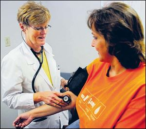 Nurse practitioners are well-trained and capable of checking blood pressure, as well as other routine checks.