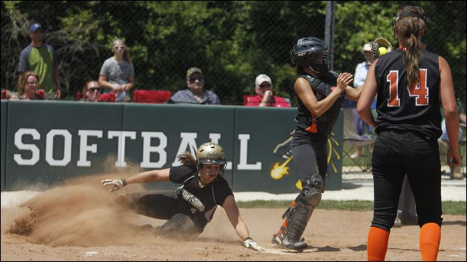 Perrysburg sails to district crown Perrysburg's Kimmy Granata scores against Ashland in the first inning of their Division I final Saturday. Granata had two hits and an RBI for the Yellow Jackets, who will face Elyria on Thursday.