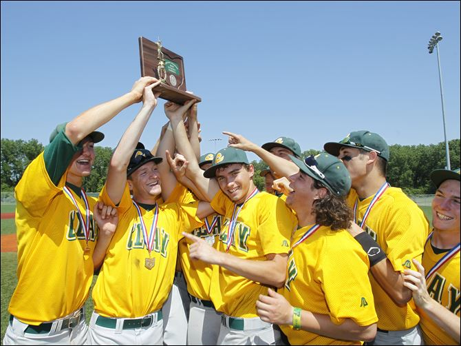 The Clay High School baseball team celebrates their Division I  The Clay High School baseball team celebrates their Division I district trophy after beating Southview 5-2 at Mercy Field on Saturday. The Eagles have gone 10-5 since starting the season 2-9.