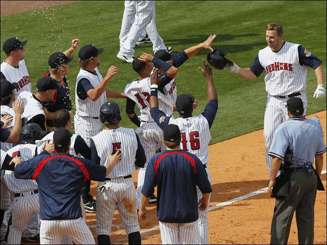 Brad Eldred greets teammates after home run Brad Eldred is greeted by teammates as he comes home after hitting a two-out, three-run home run in the bottom of the ninth inning to lift the Mud Hens to a victory Sunday over Syracuse.