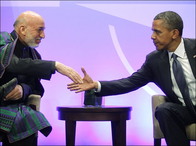 President Obama shakes hands with Afghan President Hamid Karzai during their meeting on the first day of the NATO summit in Chicago.