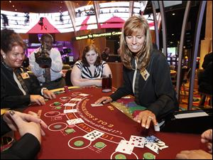 Sue Utter of Oregon practices dealing blackjack at the Hollywood Casino in Toledo. It's a trial run before the casino's opening next Tuesday.