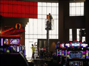Workers put finishing touches on windows of the Hollywood Casino.