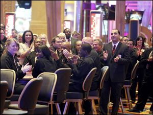 Casino workers applaud the upcoming opening of the casino during a media tour.