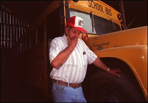 In 1992, Frank Edward Ray stood by the bus that he was driving when it was hijacked in 1976 near Fresno, Calif., with 26 summer school students on board. He bought the bus to save it from being scrapped and later donated it to a museum.