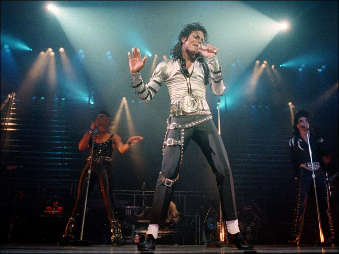 Michael Jackson The Lyrics Nov. 13, 1988 file photo, pop singer Michael Jackson performs before a sold out crowd for his Bad tour at the Los Angeles Sports Arena.