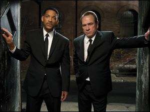 "Tommy Lee Jones, right, and Will Smith are shown in a scene from ""Men in Black 3."""