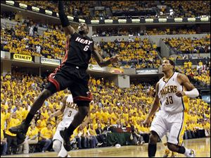 Miami Heat's LeBron James (6) shoots past Indiana Pacers' Danny Granger (33) in the second quarter of Game 6.