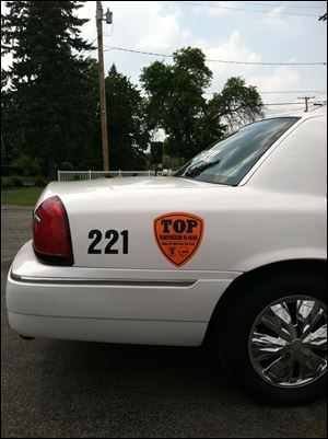 Orange Transportation on Patrol decals will be will be placed on the side of Black & White's 100 vehicles.