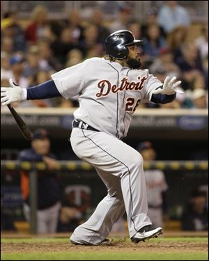 Detroit Tigers Prince Fielder watches his RBI-single during the seventh inning in a baseball game, Friday, May 25, 201