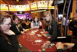 Sue Utter practices dealing blackjack at Hollywood Casino Toledo. Experts say card counters and cheaters could target the casino.