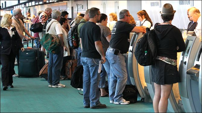 Gas prices falling as season starts Travelers crowd the ticket counter at Portland International Airport in Oregon. The total number of holiday travelers is predicted at 34.8 million this weekend.