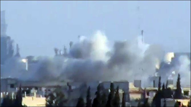 Mideast Syria This image made from amateur video released by Shaam News Network and accessed Friday purports to show shelling in Jobar, Syria.