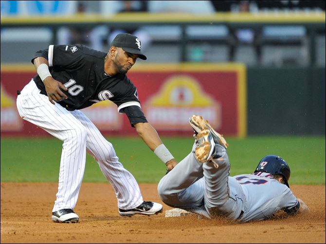 Cleveland Indians' Shelley Duncan, right, steals second base  Cleveland Indians' Shelley Duncan, right, steals second base as Chicago White Sox shortstop Alexei Ramirez tries to make a tag during the second inning of a baseball game on Friday.