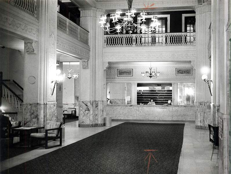 A-clerk-works-at-the-desk-in-the-empty-lobby-of-the-Waldorf-Hotel