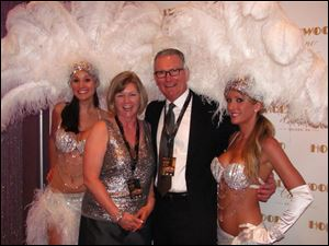 Nancy and Tim Alter pose with show girls during VIP night at the Hollywood Casino Toledo.