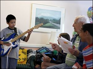Daniel Feng, a fourth grader at Woodland Elementary, plays