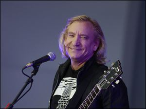 Veteran rocker Joe Walsh, who at 64 still has a laconic stoner's laid-back vibe, thoroughly entertained 2,400 concert-goers at his concert Thursday night.