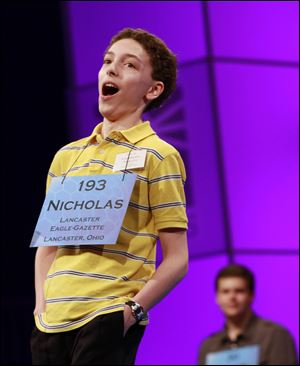 Nicholas Rushlow, 14, of Pickerington, Ohio, reacts after spelling a word correctly during the sixth round of the semifinals at the National Spelling Bee, making the five-time bee attendee one of Thursday night's nine finalists.
