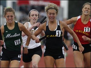 Northview's Abigail Masters, in white, maintains third place in the 3200-meter relay.