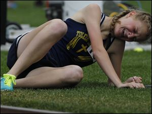 Toledo Christian's Delainey Phelps collapses after winning the 3200-relay.