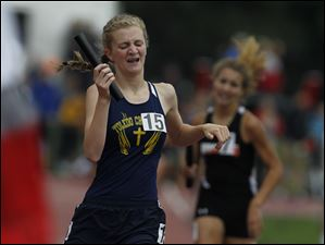 Toledo Christian's Delainey Phelps crosses the finish line to win the 3200-meter relay