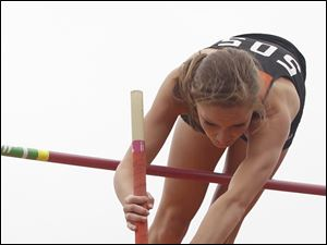 North Baltimore's Amanda Hotaling clears 12 foot, 4 inches to win the pole vault .