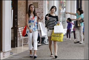 Shoppers visit the South Shore Mall in Braintree, Mass. Consumers spent more at retail stores in May than in the same month in 2011. They bought more clothes and more Mother's Day gifts.