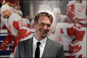 Nicklas Lidstrom, 42, set an NHL record by playing 1,564 games with a single team. He helped the Red Wings win four Stanley Cups.