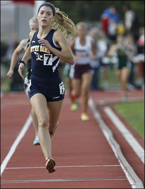 Notre Dame's Lexi Aughenbaugh runs to the finish line to win the 3200-meter run at the Division I state track meet. She finished in a personal-best time of 10:44.58.