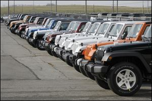 Jeep Wranglers await shipment from the Toledo Assembly Complex, Chrysler Group's sole Wrangler factory.